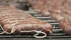 Broiling sausage on grill Stock Footage