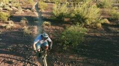 Aerial Shot of Biker on Southwestern Desert Trail - stock footage