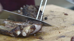 Grilled spare rib sliced on cutting board - stock footage