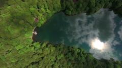 Deep forest window as Biograd lake in Bjelasica mountain, Kolasin, Montenegro. Stock Footage
