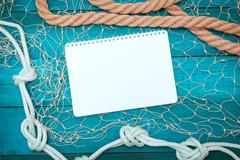 Notepad and rope on old boards Stock Photos