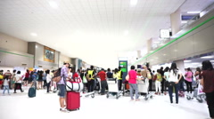 Colourful people at airport luggage belt in airport travel to Thailand Stock Footage