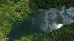 Camera rotating on high altitude over glacial Biograd lake in Bjelasica mountain - stock footage