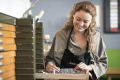 Woman with letterpress tray in printing workshop Stock Photos