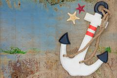 wooden anchor on the decorative background - stock photo