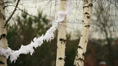 Trees decorated with paper garlands Stock Footage