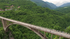 Aerial view at the Tara river canyon and spans of Durdevica bridge. Montenegro Stock Footage