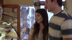 Young couple talking in bakery Stock Footage