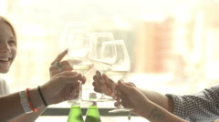 Four multiethnic friends seated on a restaurant in summer day Stock Footage