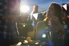 Couple at early evening party - stock photo