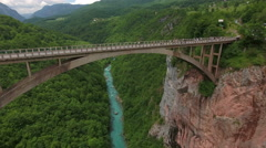 Camera flying to the Durdevica bridge. Aerial view Stock Footage