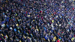 Thousands of people watching football match at stadium, big sporting event Stock Footage