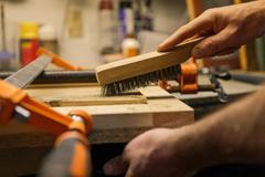 Wood artist working in workshop, close-up Stock Photos