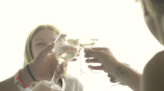 Friends make a toast and drink white wine at italian restaurant - stock footage