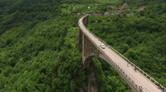 Durdevica concrete arch bridge with cars driving at Tara River canyon Stock Footage