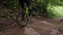 Extreme Mountain Biking Jumping on trail Stock Footage