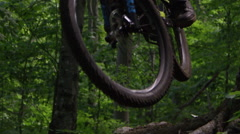 Extreme Mountain Biking - Slow motion tires suspended in the air on a jump Stock Footage