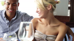 Young couple chattering at restaurant in summer day - stock footage