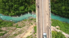 Camera follows car driving on the Durdevica bridge. Montenegro Stock Footage