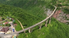 Aerial view at the vehicular Durdevica bridge connecting two sides of Tara river Stock Footage