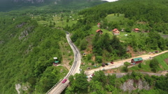 Road passing through the village on the one side of Tara river canyon. Stock Footage