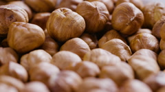 hazelnut falling in 180fps slow motion - stock footage