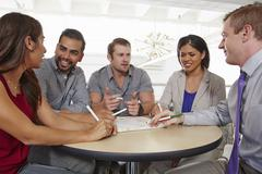 Small group of people having brainstorming business meeting Stock Photos