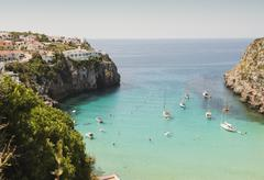 Elevated view of two boats and yachts anchored in bay, Menorca, Balearic Stock Photos