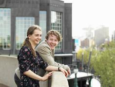 Young couple enjoying view from terrace, Melbourne, Victoria, Australia - stock photo