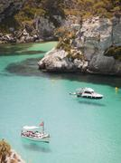 Elevated view of two boats anchored in bay, Menorca, Balearic islands, Spain - stock photo