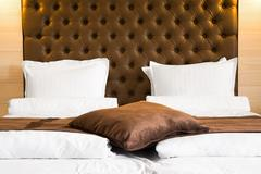 Luxury queen-size bed with upholstered headboard Stock Photos