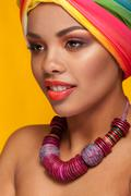 Afro american young woman wearing a turban and necklace Stock Photos