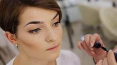 Close-up of separating and curling lashes process with mascara brush, beautiful - stock footage