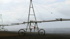 Center pivot with drop sprinklers in a field Stock Footage