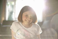 Sunlit illuminated portrait of smiling girl Stock Photos