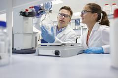 Scientists using rotary evaporator in laboratory Stock Photos