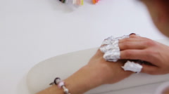 Step of manicure process: nail gel polish removal using foil pieces - stock footage