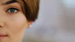 Close-up of eye with black arrow of fashion brunette with stylish short - stock footage