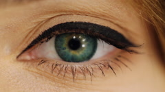 Elegance close-up of beautiful female eye with fashion eye shadow and eyeliner - stock footage