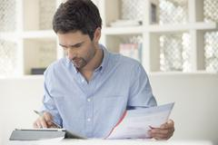 Man using online banking to manage personal finances Stock Photos