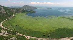 Intercity route around Skadar lake leading to Sozina tunnel Stock Footage