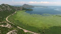 Vehicular highway and railroad around Skadar lake. Montenegro Stock Footage