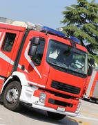 Red fire engine truck on the road after the emergency call Kuvituskuvat