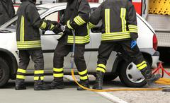 brave firefighters relieve an injured after an accident during a practice ses - stock photo