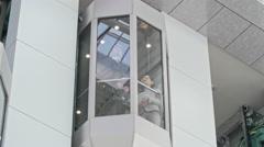 Riding Modern Glass Elevator Stock Footage
