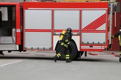 Firefighter running during a training exercise with the oxygen cylinder and t Stock Photos