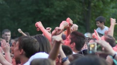 Spectators people crowd music fans by concert stage cheerfully jump raise hands - stock footage