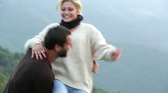 Young beautiful romantic couple have fun outdoor on mountain Stock Footage
