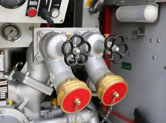 Large fire control equipment with taps and hoses of firefighters in fire engi Stock Photos