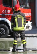 Isolated Italian fireman with protective uniform and red helmet on his head Stock Photos